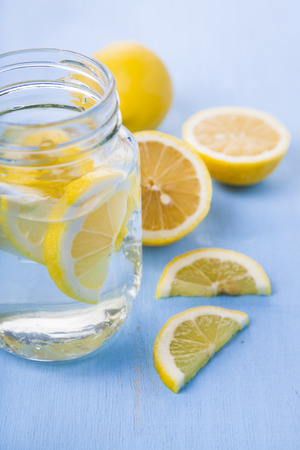 Refreshing ice cold water with lemon ready to drink. Concept of diet.  Diet for weight loss.