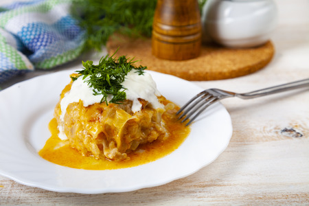 Lazy cabbage rolls on a wooden table. Delicious homemade dinner. Stock Photo