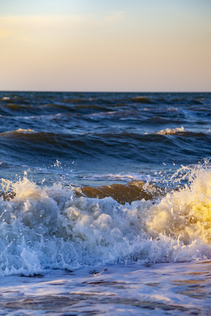 Beautiful sea at sunset. Seascape. Waves close up.