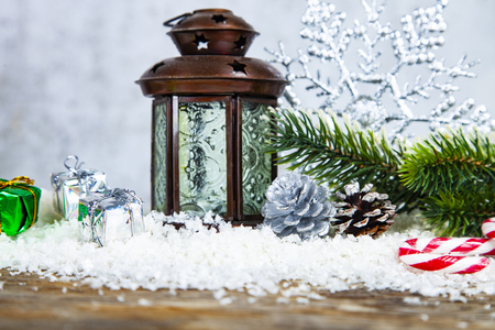 Christmas lantern, fir branch and snowflake on grunge background. Christmas decor. Stock Photo