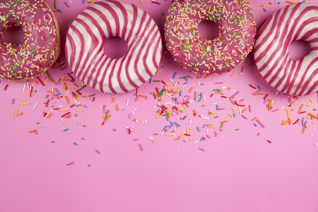 Donuts  on a pink background. Delicious dessert.