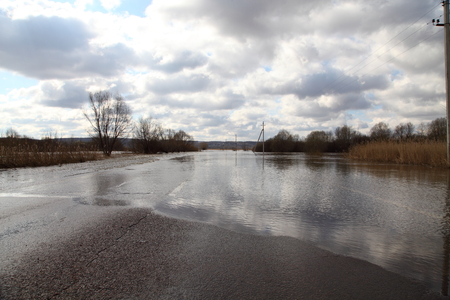 Water flooded the road. Spring flood of the river. Stock fotó