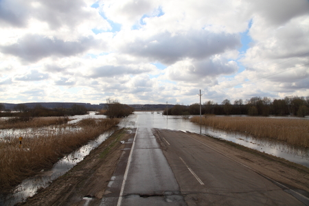 Water flooded the road. Spring flood of the river. Reklamní fotografie