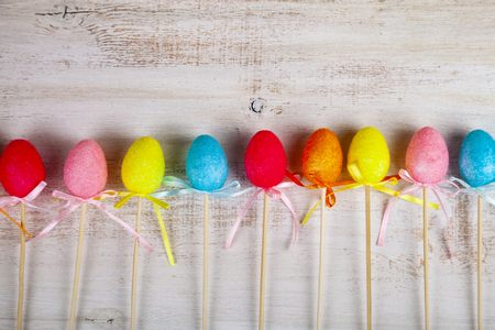 Easter eggs on wooden background. Easter still life.Border of colorful Easter eggs.