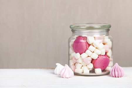 Meringue and marshmallow in a glass jar. Delicious dessert.