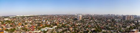 Aerial view of the city. Summer day. Residences and skyscrapers.Panorama.