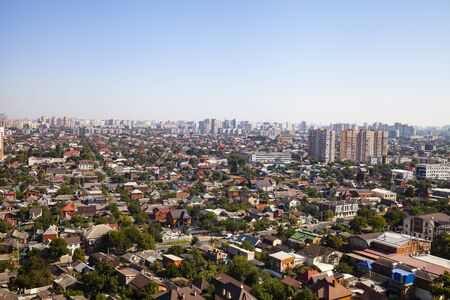 Aerial view of the city. Summer day. Residences and skyscrapers. Stock Photo