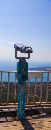 Spyglass on the observation deck. Blue sky and sea below.