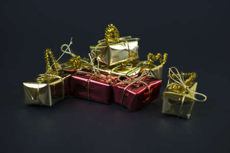 mini gifts in black background Stock Photo
