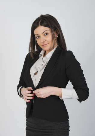 buttoning: Beautiful girl with suit Stock Photo