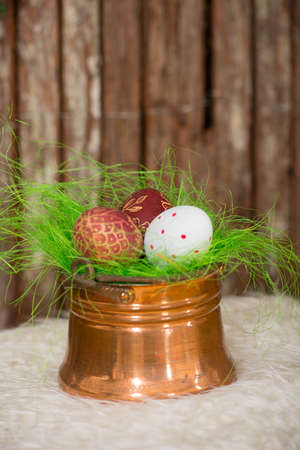 Easter eggs in copper bowl Stock Photo