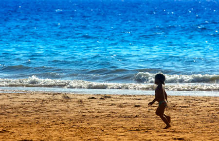 little girl running on the beach in summer Stock Photo - 475367