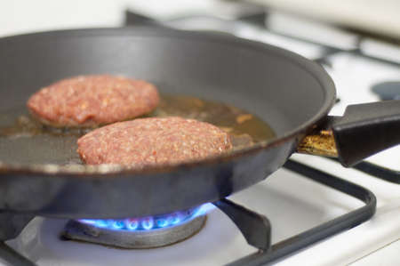 cooking meat on a stove photo
