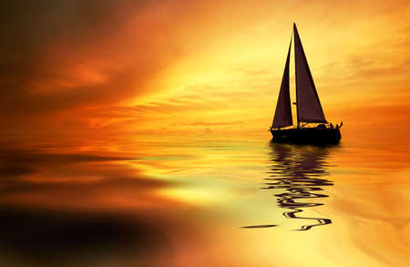 yellow boats: Sailboat against a beautiful sunset