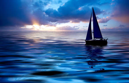 Sailboat against a beautiful sunset Stock Photo - 656185