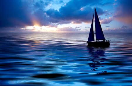 Sailboat against a beautiful sunset Stock Photo - 656185