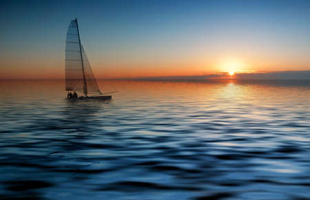 yellow boats: Sailing with a beautiful sunset