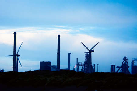distill: Industry and windmills with a blue sunset sky