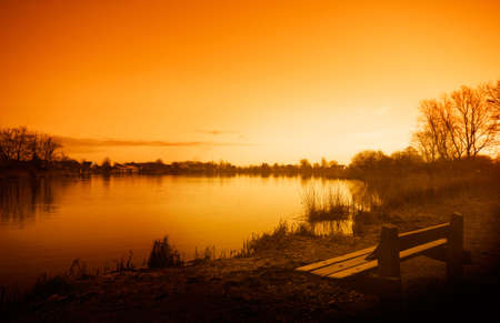 Sunrise, early in the morning at a lake Stock Photo