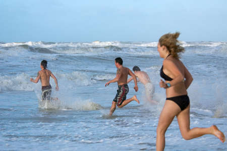 people running into ocean Stock Photo - 765058