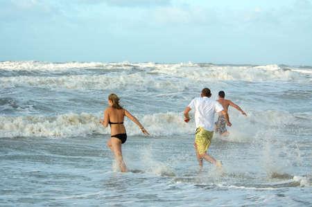 people running into ocean Stock Photo - 765059