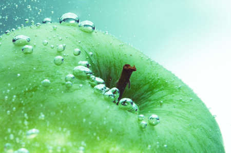 fresh green apple and water bubbles
