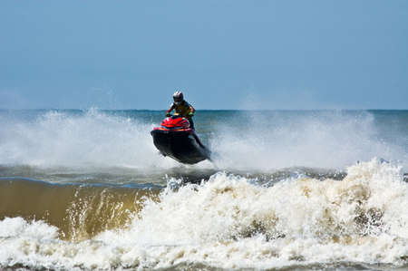 extreme  jet-ski watersports with big waves photo