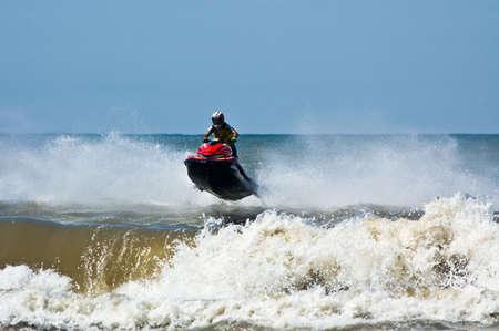 extreme  jet-ski watersports with big waves photo