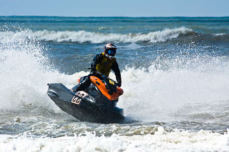 jetski: extreme  jet-ski watersports with big waves Stock Photo