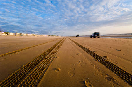 cars driving on the beach  photo