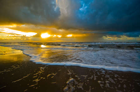screensaver: Beautiful sunset and waves on the beach