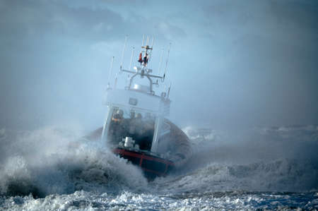 coast guard during storm in ocean  photo