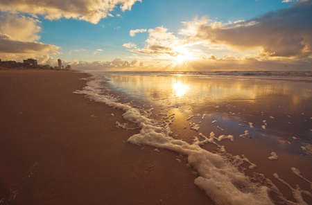 Beautiful sunset and waves on the beach photo