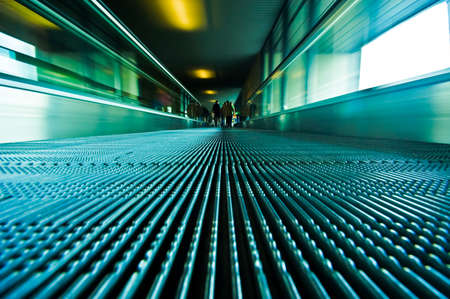jetliner: abstract image of people traveling on a moving escalator at airport taken with an ultra wide angle lens