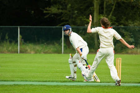 an umpire: cricket player just about to throw the ball Stock Photo