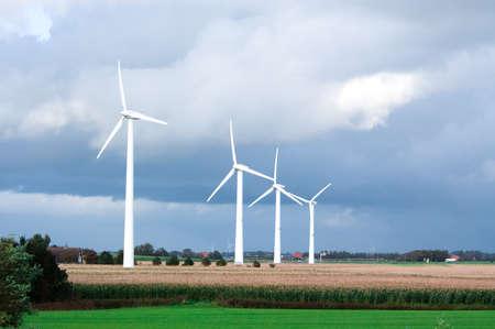 windmills on farmland photo