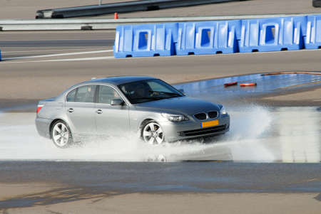 overtake: car brake training in wet conditions