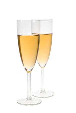 two glasses filled with champagne isolated on a white background photo
