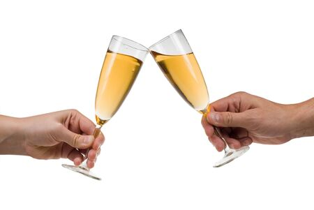 Man and woman toasting champagne isolated on a white background photo
