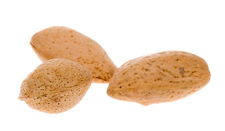 almonds in shell isolated on a white background photo