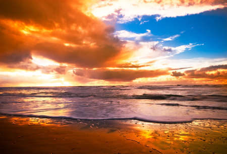 beautiful sunset and waves on the beach Stock Photo - 2247116