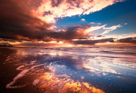 beautiful sunset and waves on the beach Stock Photo - 2247117