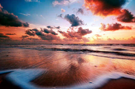 beautiful sunset and waves on the beach Stock Photo - 2247113