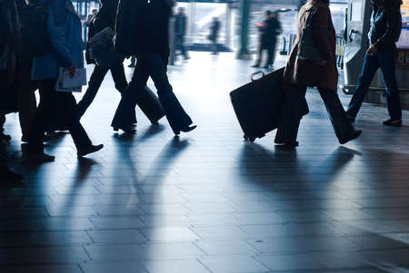 people traveling at the airport ( motion blur) photo