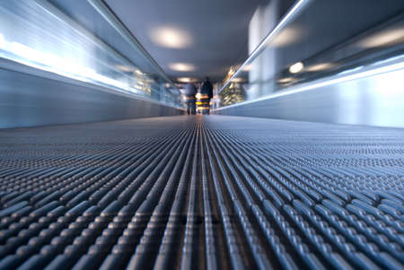 abstract image of people traveling on a moving escalator (BLURRY !) photo