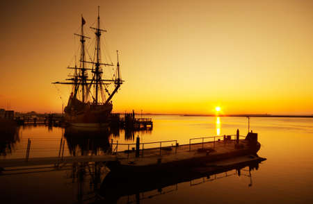 sea dock: An old ship and sunset Stock Photo
