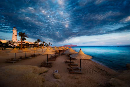 sunset and turquoise ocean in sharm el sheikh, egypt photo