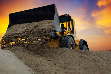 Bulldozer at work with sunset background Stock Photo - 2450481