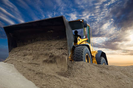 Bulldozer at work with sunset background Stock Photo - 2450483