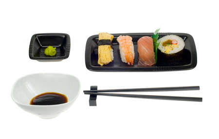 assortment of sushi on a plate,  isolated on a white backgroud photo